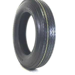 a black tire with yellow rims