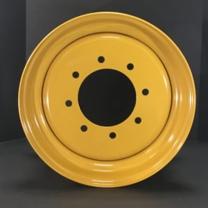 a yellow circular object with holes