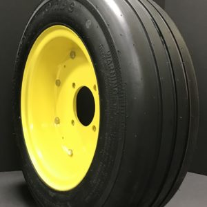 a black tire with a yellow rim